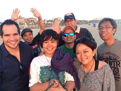Carlos takes a group of Indonesian visitors to picnic at Santa Monica Beach as part of hosting them for home hospitality